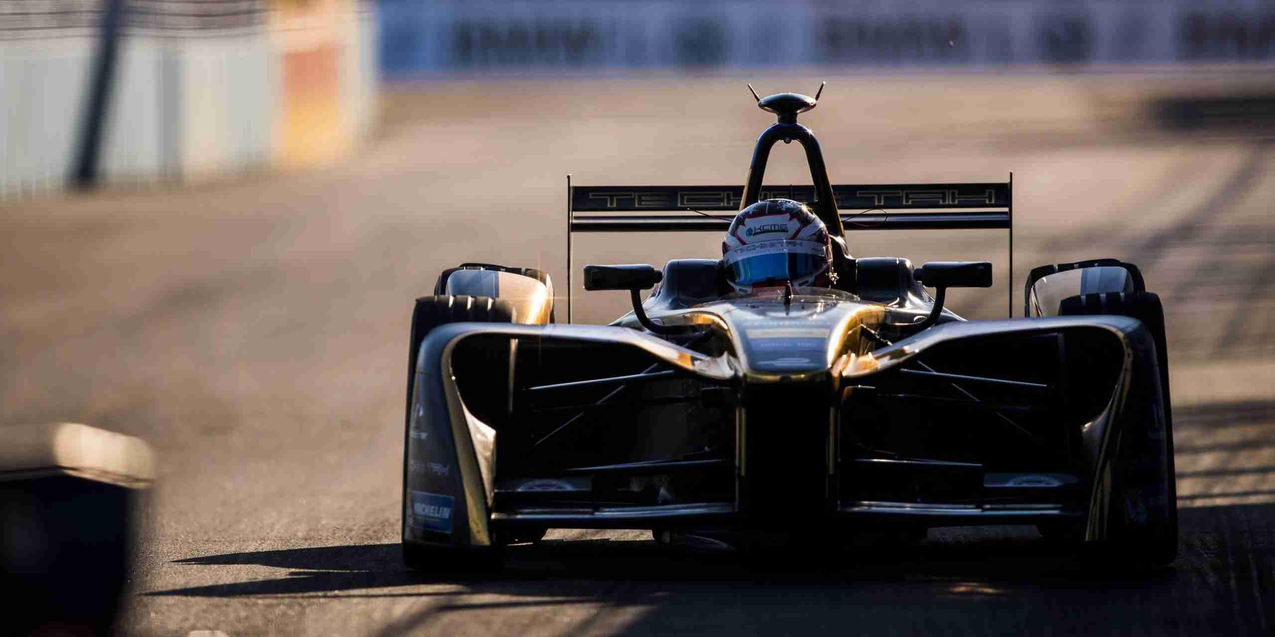 Formula-E car races on a track