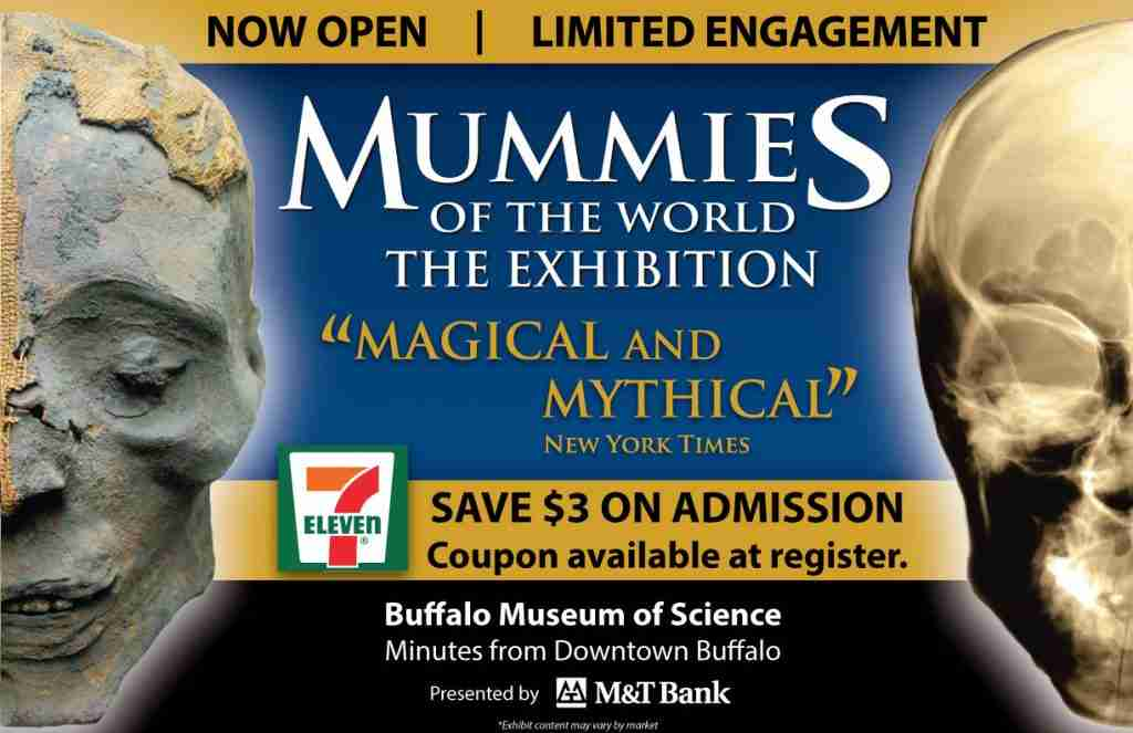 Window cling advertising for Mummies of the World with 7-Eleven coupon